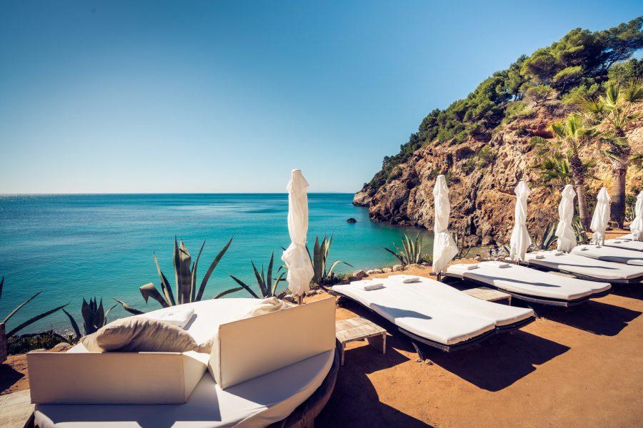 Sunbeds at Amante Ibiza with views of Cala Nova Bay