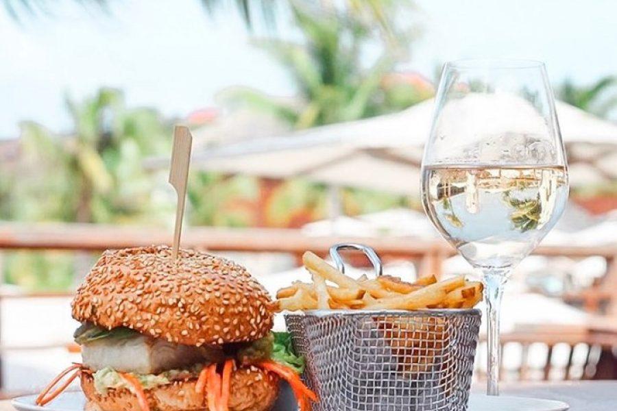 Mahi mahi burger and chips beachside at Le Barthélemy