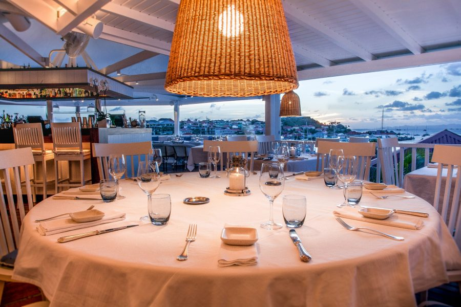 Large dining tables with views of Gustavia harbour at Bonito St Barts