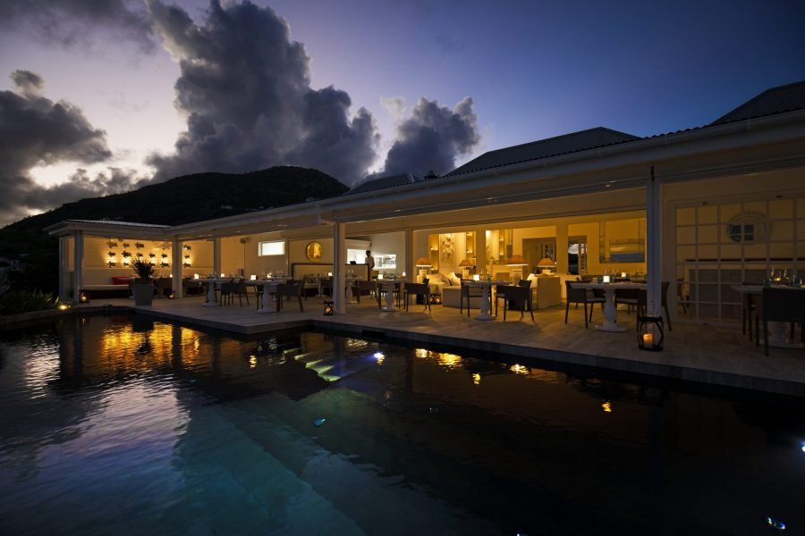 Sunset Views of the pool and restaurant at Hotel Le Toiny St Barts
