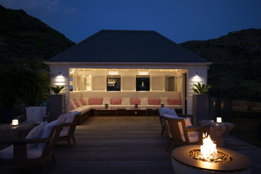 Lounge area at night with fire pit at Hotel Le Toiny St Barts