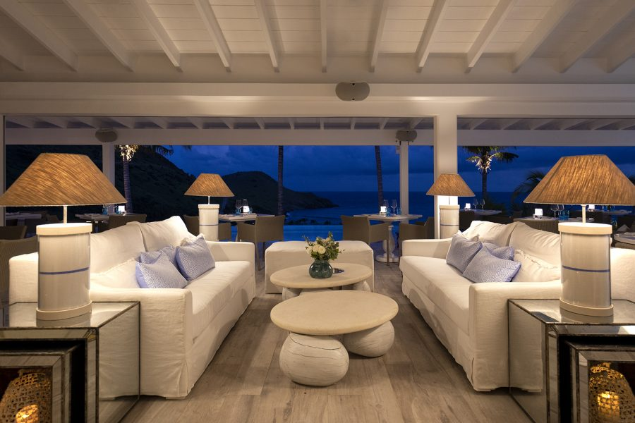 Sofa area at night with views of the Caribbean Sea at hotel Le Toiny St Barts